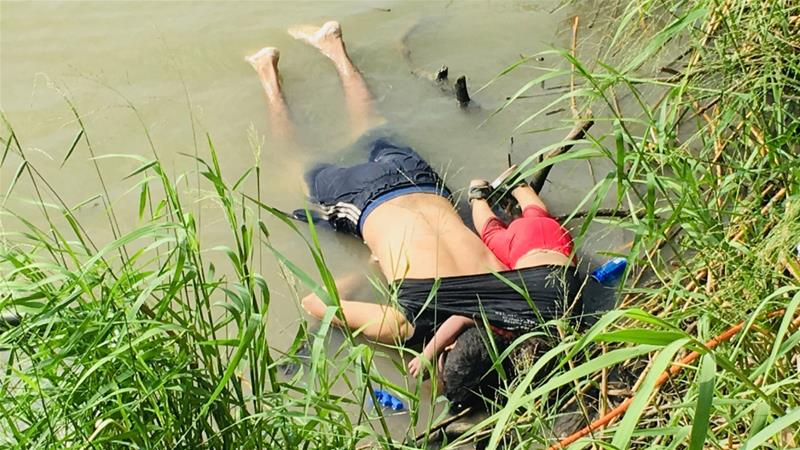 The bodies of Salvadoran migrant Oscar Alberto Martínez Ramírez and his nearly 2-year-old daughter Valeria lie on the bank of the Rio Grande in Matamoros, Mexico [Julia Le Duc/AP Photo]