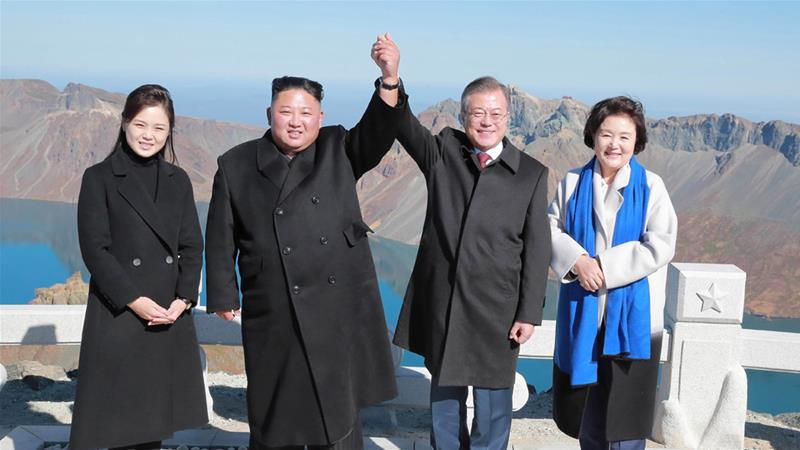 North Korean leader Kim Jong Un and South Korean President Moon Jae-in pose for photographs with their wives last year [KCNA via Reuters]