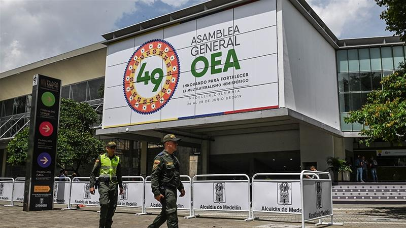 Policemen patrol outside the Plaza Mayor convention center where the OAS's 49th General Assembly will take place in Medellin, Colombia [Joaquin Sarmiento/AFP]