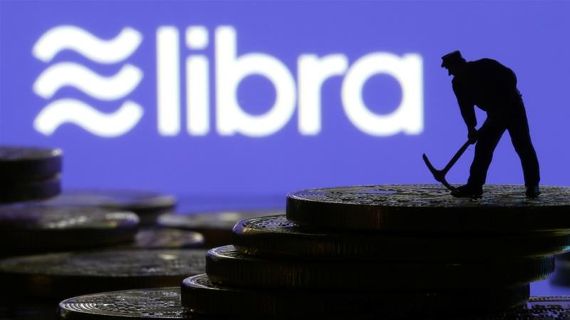 Libra could fundamentally challenge the role of central banks in determining monetary policy, economists report [Dado Ruvic/Illustration/Reuters]