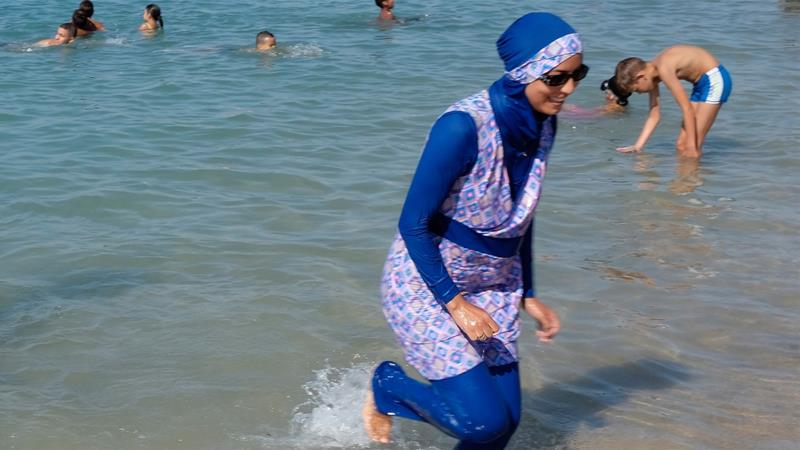 4fe44493045 French women are demanding that public pools change regulations to  accommodate burkini wearers [File: