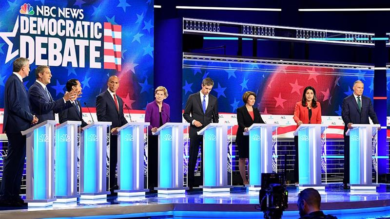 Democratic presidential candidates take part in the first night of the Democratic presidential debate [Joe Raedle/Getty Images/AFP]