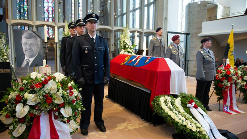 An honour guard accompanies the coffin of Kassel District President Walter Luebcke during his funeral on June 13 [Swen Pfoertner/Pool/Reuters]