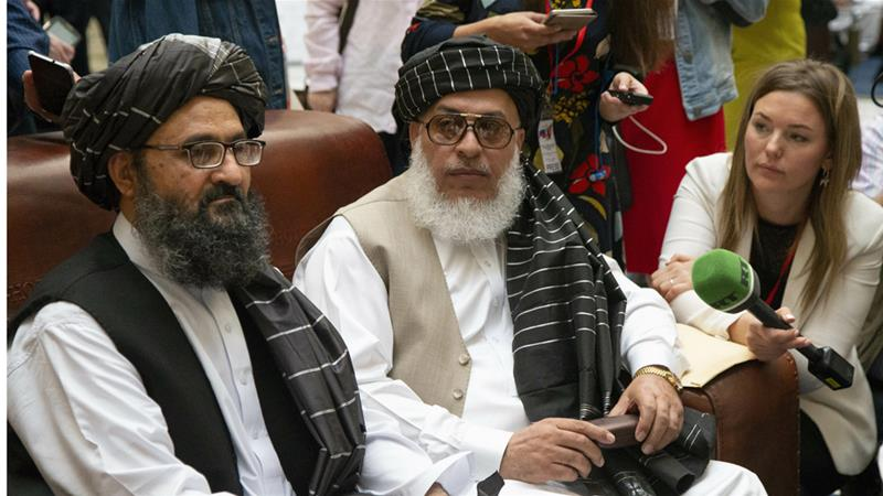 The Taliban's top political leader, Mullah Abdul Ghani Baradar, left, and chief negotiator Sher Mohammad Abbas Stanikzai, met Afghans in Moscow last month [File: Alexander Zemlianichenko/AP]