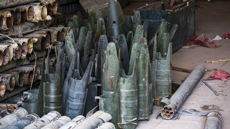Remains of missiles and other weapons found at a camp that was used by forces loyal to Libyan renegade commander Khalifa Haftar in Gharyan [Mahmud Turkia/AFP]