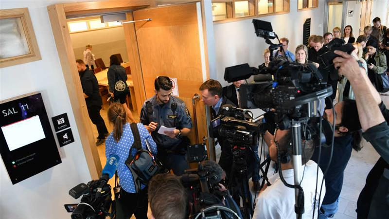 Reporters gather at the Uppsala District Court ahead of Monday's ruling in Julian Assange's case [Fredrik Sandberg/TT News Agency/Reuters]