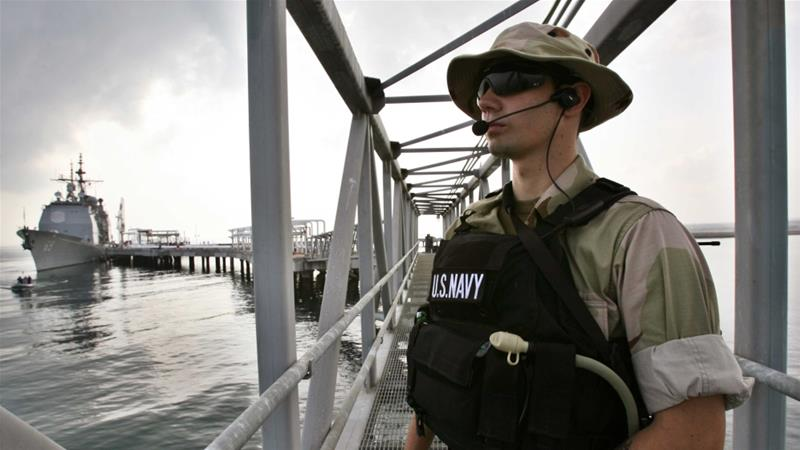 US Navy personnel guard the US military ship USS Vicksburg during the opening ceremony of a DP World-managed oil terminal facility in Djibouti in 2006 [File: Reuters/Ahmed Jadallah]