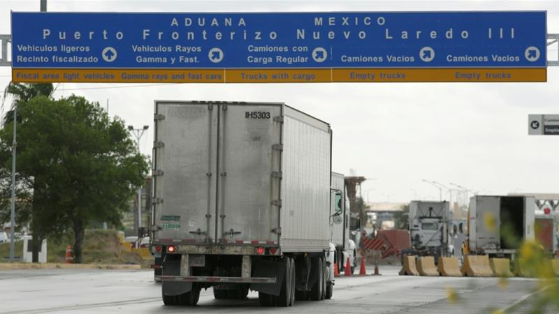 US President Trump has 'indefinitely suspended' a threat to impose tariffs on imports from Mexico following an agreement by Mexico to help curb the numbers of people crossing into the US [Daniel Becerril/Reuters]