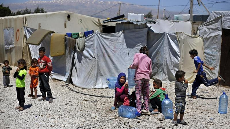 Syrian refugee children outside their family tents at a camp in the town of Bar Elias in Lebanon [File: Bilal Hussein/AP]