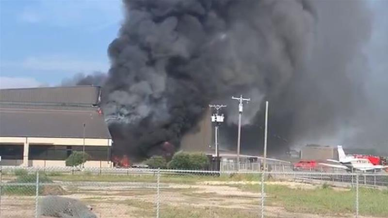 A massive column of black smoke poured out of a building at the airport in Addison after the crash [Ian Johnson]