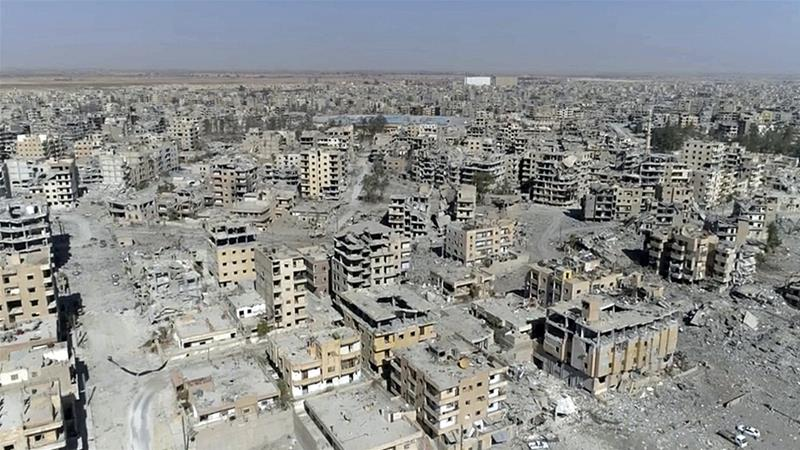 ISIL's bombs and US-led coalition air raids have left much of Raqqa in ruins [Gabriel Chaim/AP]