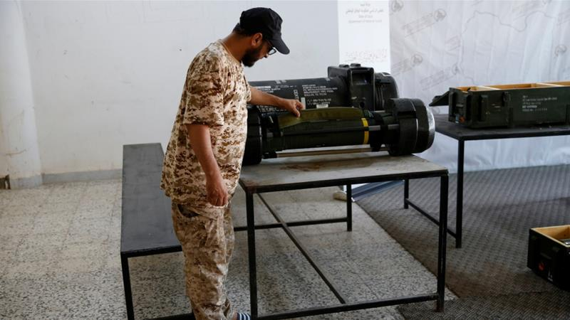 A member of forces allied to Libya's internationally recognised government looks at confiscated missiles [File: Ismail Zitouny/Reuters]