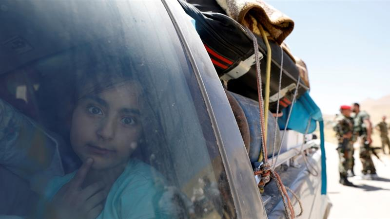 A Syrian refugee girl who left Lebanon looks through a window as she arrives in Qalamoun, Syria June 28, 2018 [File: Omar Sanadiki/Reuters]