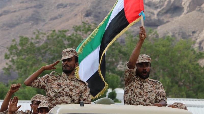 An Emirati forces-trained recruit of Yemen's army waves a UAE flag during combat exercises [File: Najeeb Almahboobi/EPA-EFE]