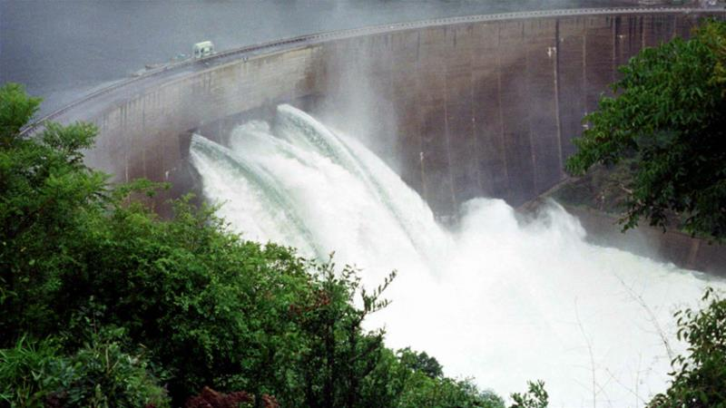 The floodgates on the Kariba Dam wall are opened only rarely, such as in this picture from the year 2000 [Stringer/Reuters]