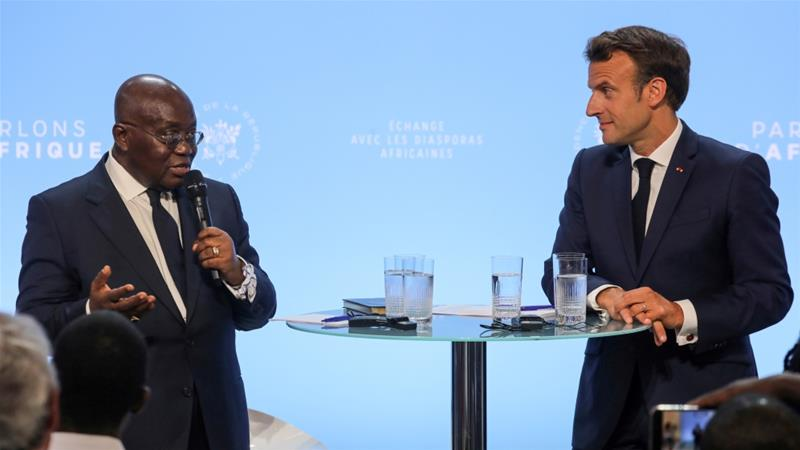 Nana Akufo-Addo, left, said Africa and Europe's historical relationship had only enriched the latter [Ludovic Marin/Reuters]
