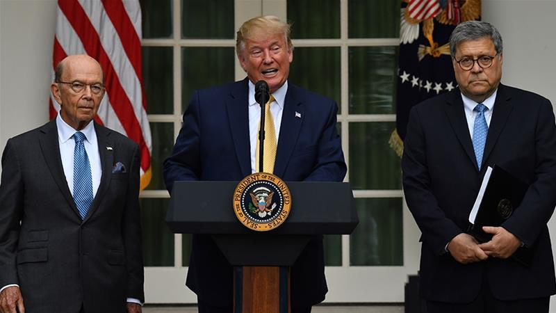 Trump, flanked by US Secretary of Commerce Wilbur Ross and US Attorney General William Barr, delivers remarks on citizenship and the census in the Rose Garden at the White House [Nicholas Kamm/AFP]