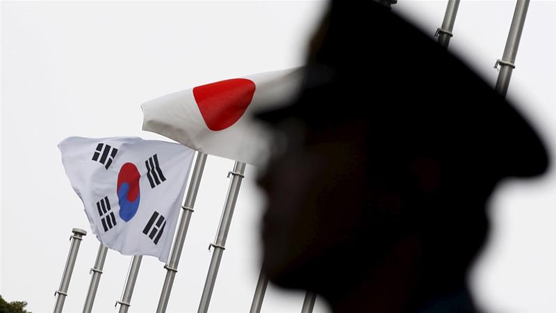 At the root of the diplomatic row between the two US allies is compensation demanded by Seoul for South Koreans forced to work for Japanese firms during World War Two [Toru Hanai/Reuters]