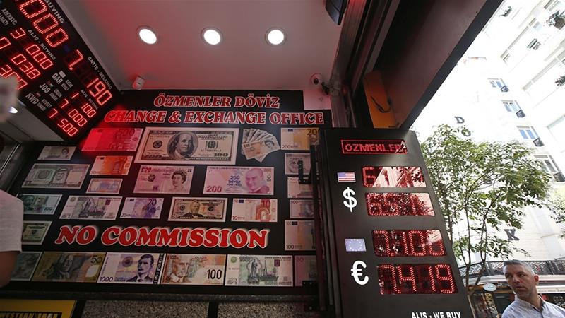 Turkey's official currency, the lira, lost some of its value against the US dollar on Friday after the country received parts of a Russian missile system that the US opposes [Lefteris Pitarakis/The Associated Press]