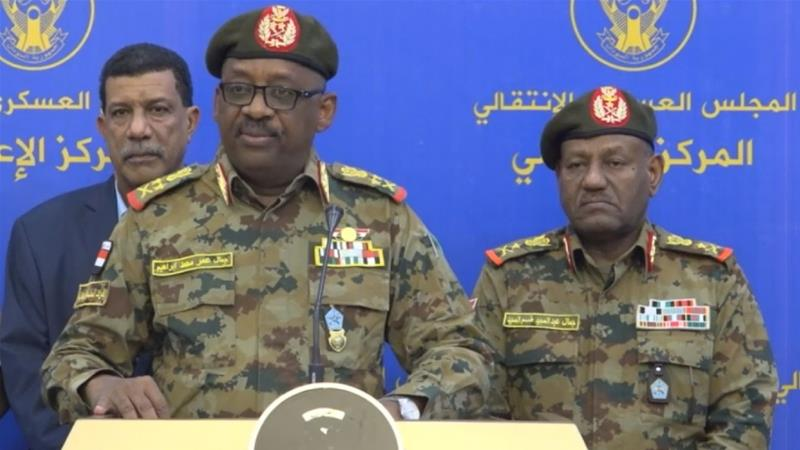 A screen grab captured from the statement broadcast live on state-run television shows General Jamal Omar (front), chairman of the ruling military council's Committee on Security and Defense, declares that it had foiled an attempted coup in Khartoum
