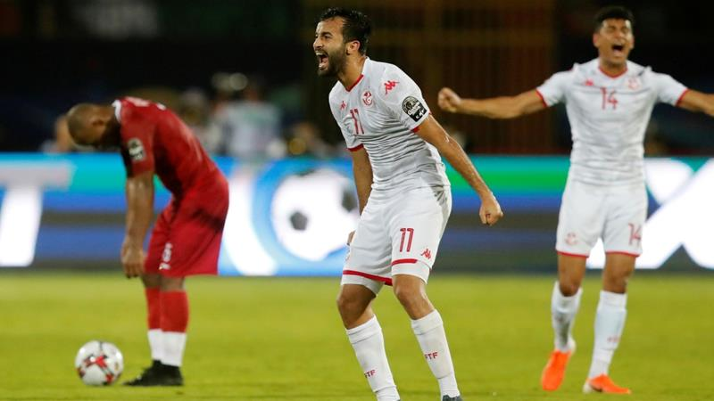 Tunisia striker Taha Yassine Khenissi celebrates after the match against Madagascar at Cairo's Al-Salam Stadium [Amr Abdallah Dalsh/Reuters]
