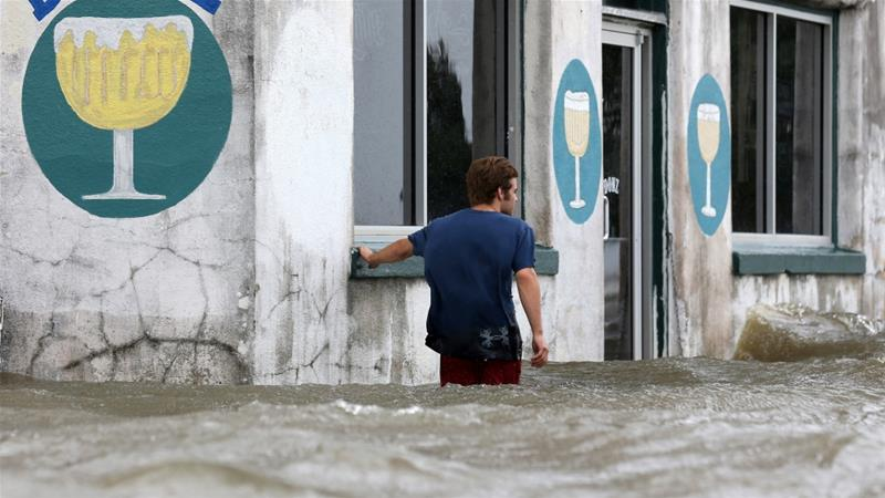 The National Hurricane Center warned people of storm surges, strong winds and rain [Jonathan Bachman/Reuters]