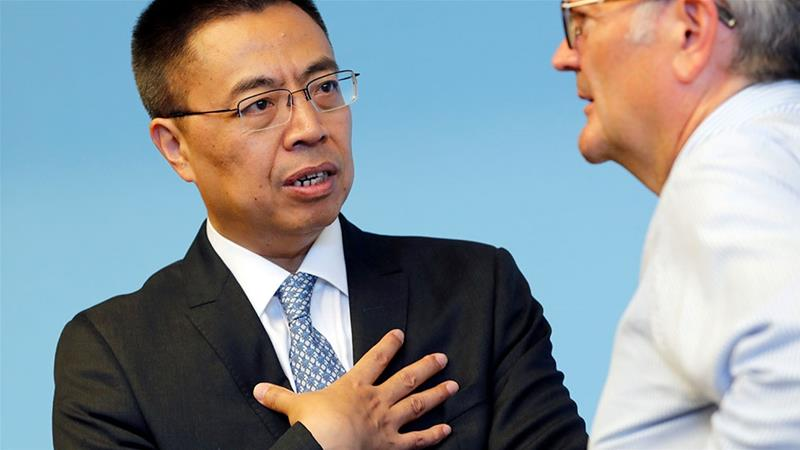 Zhang Xiangchen, left, the Chinese Ambassador to the World Trade Organization, speaks with Roberto Azevedo, Director of Information for the WTO, which has just ruled in China's favour [Denis Balibouse/Reuters]
