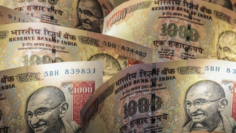 "India's Ministry of Finance has announced plans for its first foreign currency bond sale, which could raise an estimated $10bn for the country though critics are calling it a ""dangerous move"" [Dhiraj Singh/Bloomberg]"