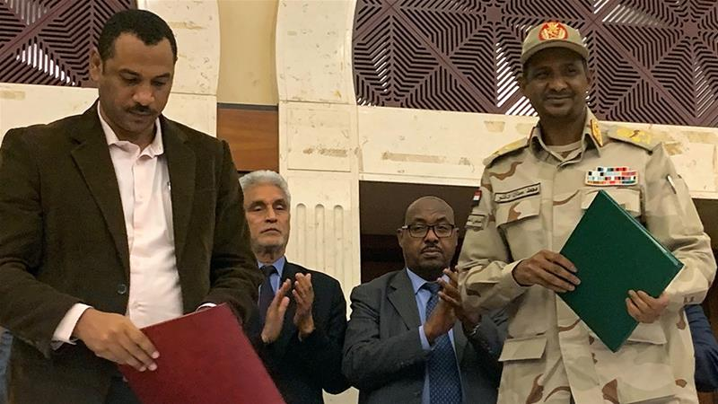 The agreement was signed in Khartoum after marathon overnight talks [Haitham El-Tabei/AFP]
