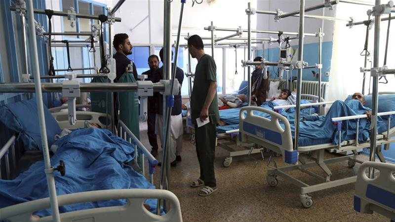 At least 12 killed, dozens wounded in Afghanistan Taliban auto bombings