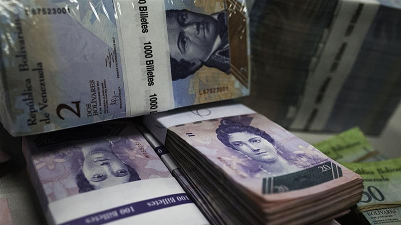Some economists say the price change may be due to increased public spending and an overvalued bolivar [Bloomberg]