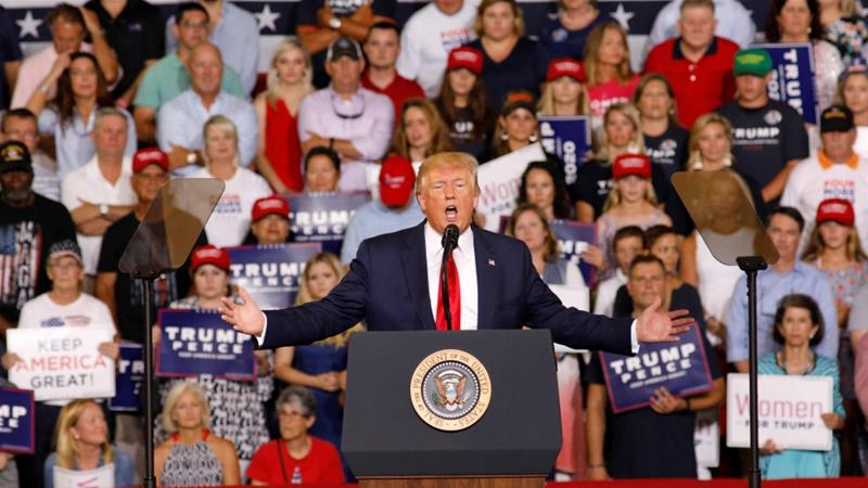 US President Donald Trump attacked US Representative Ilhan Omar at a July 17 campaign rally in Greenville, North Carolina, causing the crowd to chant 'send her back' [Reuters/Jonathan Drake]
