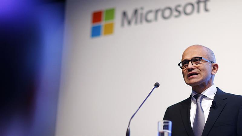 Microsoft's chief executive Satya Nadella said on Thursday the company had 'a record fiscal year' as a result of partnerships with leading companies in every industry [Hannibal Hanschke/Reuters]