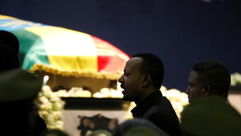 Ethiopia's Prime Minister Abiy Ahmed walks past the coffin of Army Chief of Staff Seare Mekonnen during a memorial ceremony in Addis Ababa, Ethiopia June 25, 2019 [Baz Ratner/Reuters]