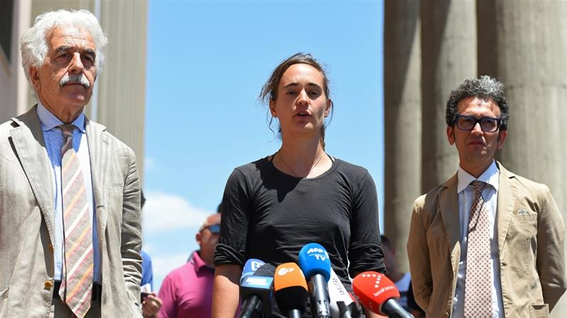 Rackete addresses media after a hearing over accusations she aided undocumented immigration in Agrigento, Sicily [Guglielmo Mangiapane/Reuters]