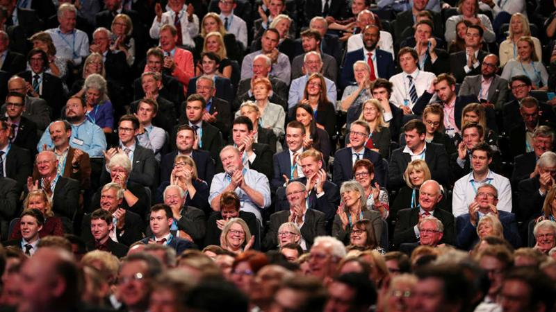 Conservative Party conferences are an opportunity for its members to network [File: Hannah McKay/Reuters]