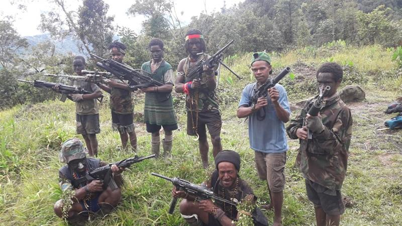 Child soldiers stand among fighters from the West Papua Liberation Army, the largest rebel group in the territory [Supplied/Al Jazeera]