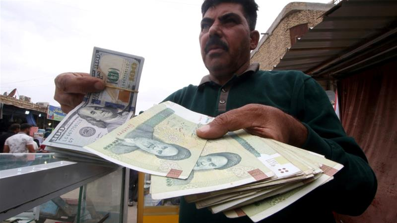 Economic sanctions and financial hardships have given rise to a multitiered system of exchange rates in Iran [File: Essam al-Sudani/Reuters]