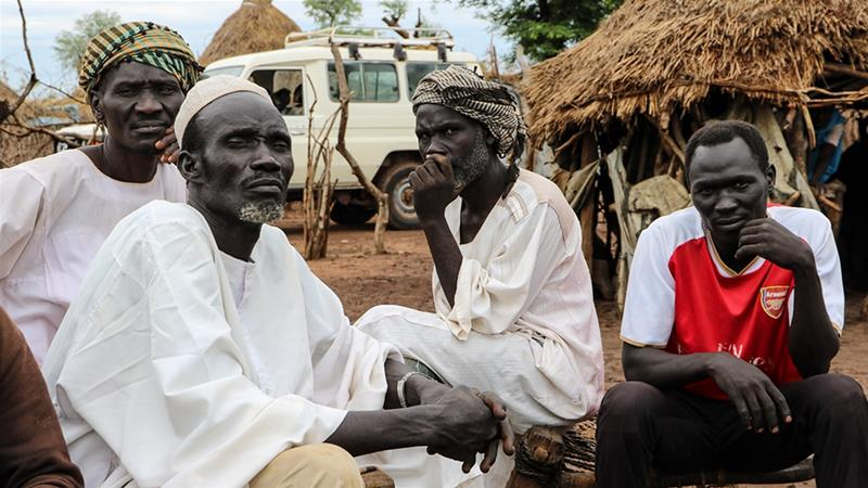 Sudanese refugees are calling on South Sudan's President Salva Kiir to mend relations in Sudan [Sam Mednick/Al Jazeera]