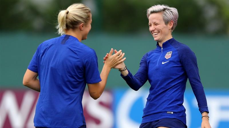 Dahlkemper (L) shares a joke with teammate Rapinoe during a training session in Lyon [Getty Images]