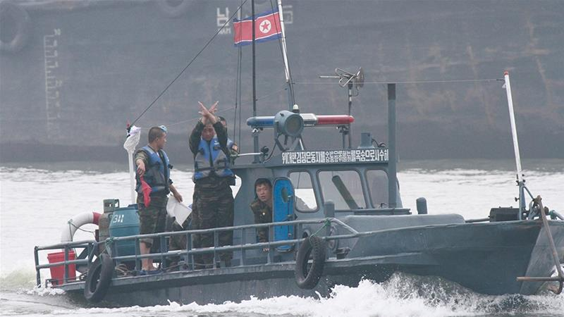 In this file photo, North Korean policemen ask a fishing boat to stop for an inspection on the Yalu River near the North Korean town of Sinuiju  [Jacky Chen/Reuters]