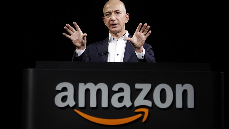 Jeff Bezos, founder, chairman and chief executive of Amazon, Inc., the world's largest online retailer, said the company is seeing faster sales growth from its Prime offering, but expects income to fall this quarter [Reed Saxon/The Associated Press]