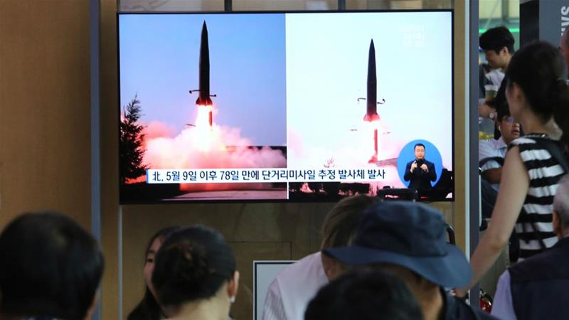 People watch a TV showing file images of North Korea's missile launch during a news programme at the Seoul Railway Station [Ahn Young-joon/AP Photo]