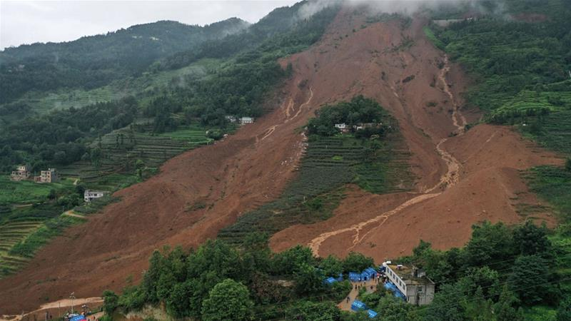 Rescue personnel assemble at the foot of a mountain after a landslide occurred in the southwest China's Guizhou province [Reuters]