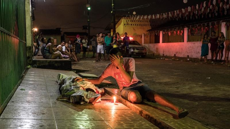 A man grieves after a murder in Belem [Tommaso Protti/Al Jazeera]