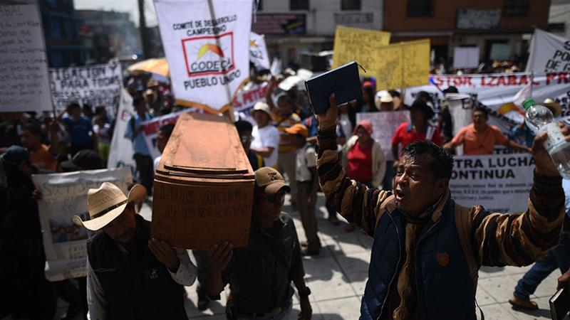 Guatemalans protest against President Jimmy Morales and demand justice for the murders of those killed while defending the right to land and natural resources [Edwin Bercian/EPA]