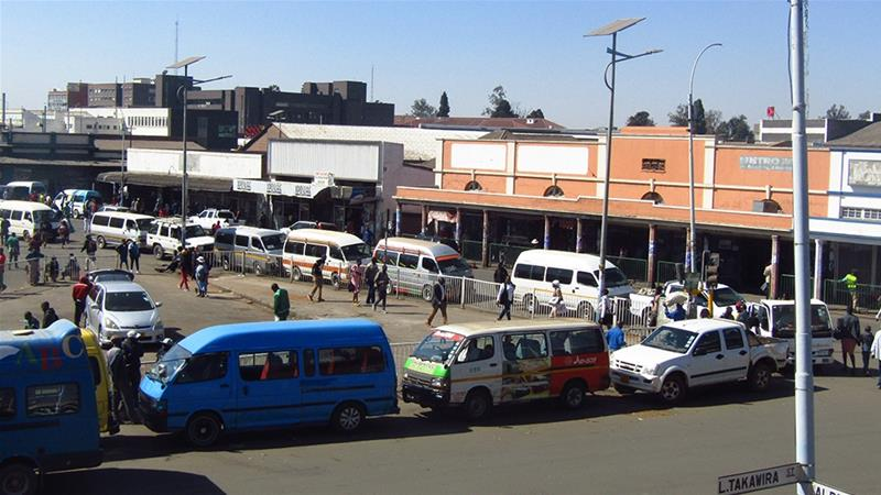 Buses in Harare queue to fill up with diesel, before fuel prices in Zimbabwe rise again [Chris Murzoni/Al Jazeera]