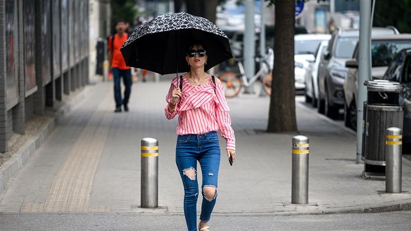 Temperatures across parts of China have almost nudged 40 degrees Celsius [Fred Dufour/AFP]