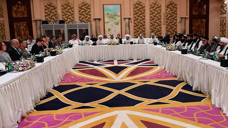 Qatari, US and Taliban officials meet for talks in Doha in one of the earlier rounds of talks [File: Qatar Ministry of Foreign Affairs via AP]