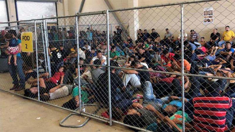 An overcrowded fenced area holding families at a border facility in Texas. Picture pixelated at source. [File: Office of Inspector General/DHS/Handout via Reuters]